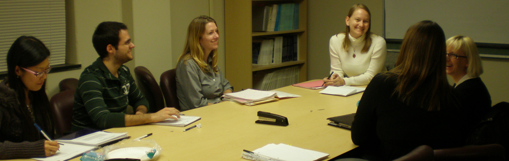 Dr. Buckner with graduate student therapists in clinical supervision