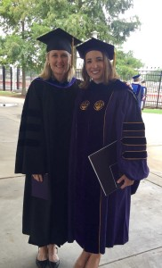 MacKenzie Peltier, Ph.D. and Amy Copeland, Ph.D. after the doctoral program graduation ceremony