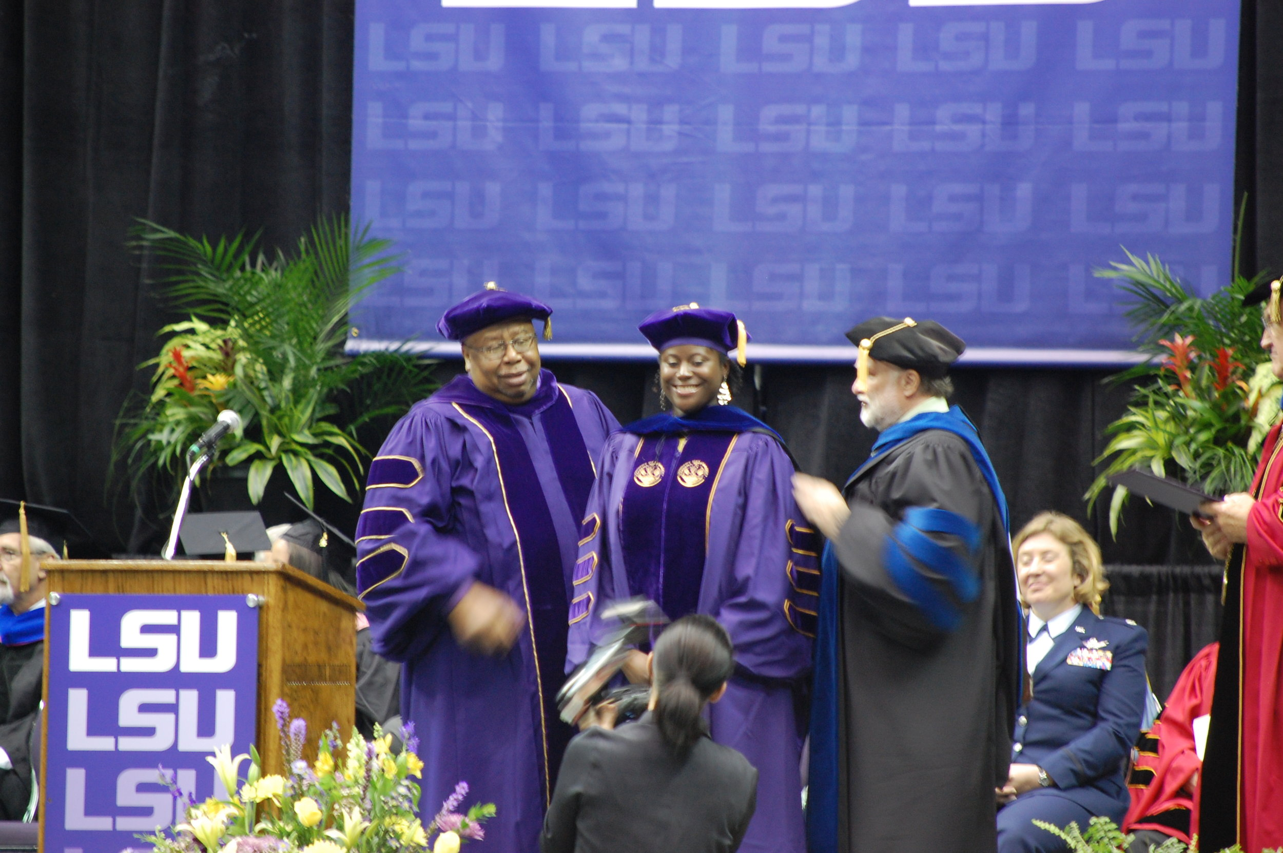 Dr. Warner hooding Ph.D. candidate, Dr. Ashleigh Wright.